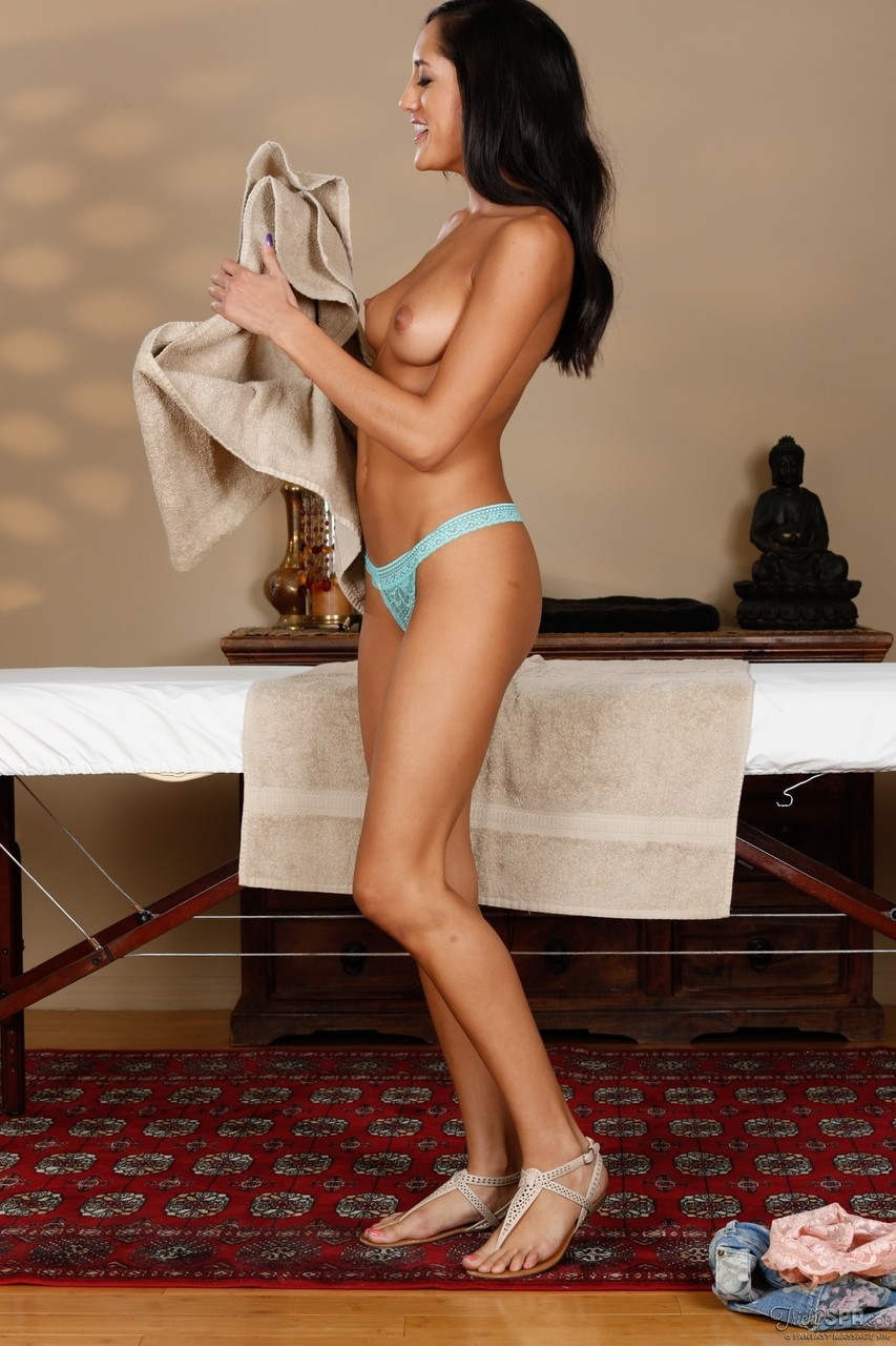 Petite brunette Chloe Amour shows her natural tits in the massage parlor