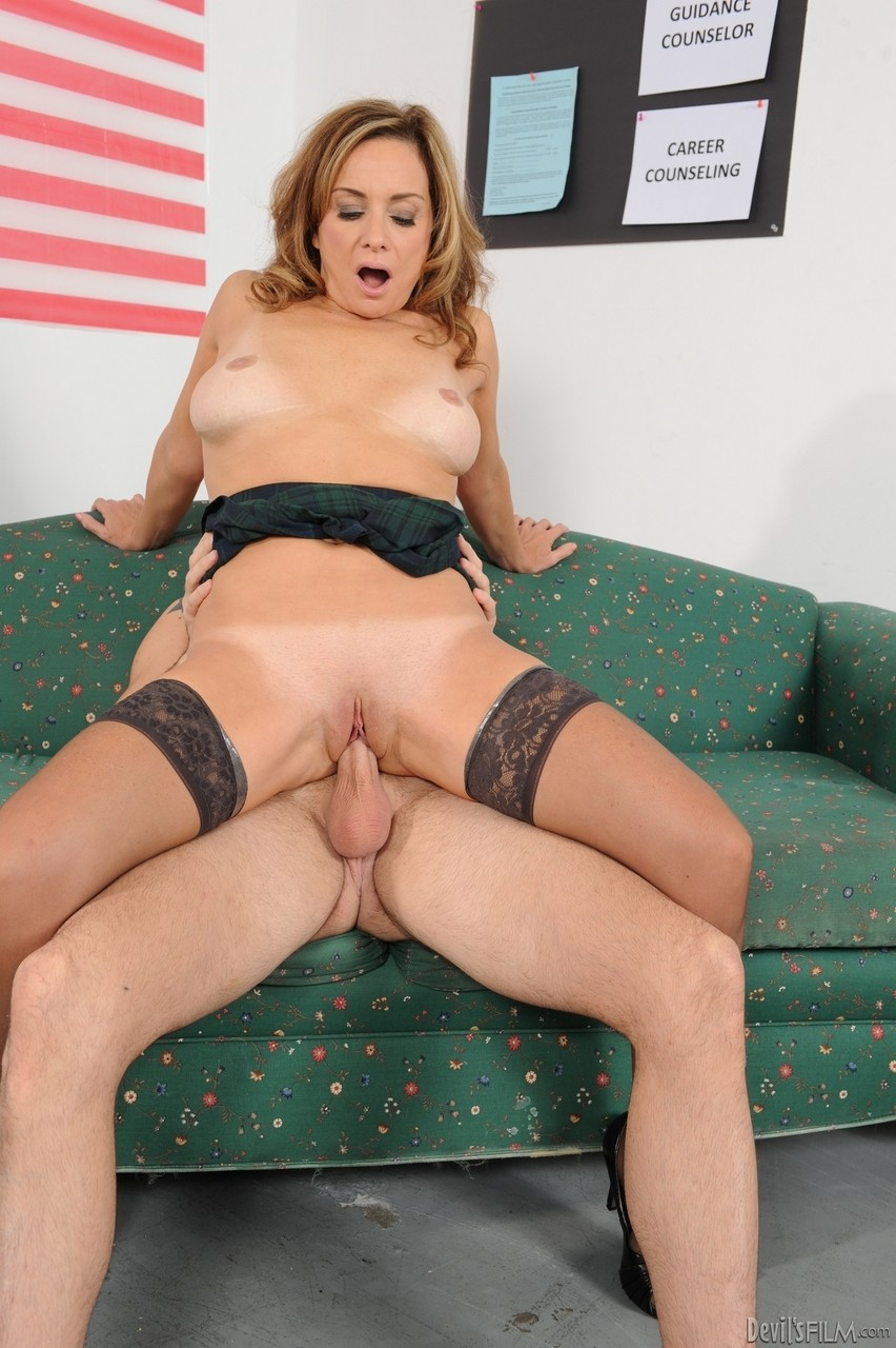 Hot pornstar MILF in sexy stockings sucking fat dick and riding it like a pro