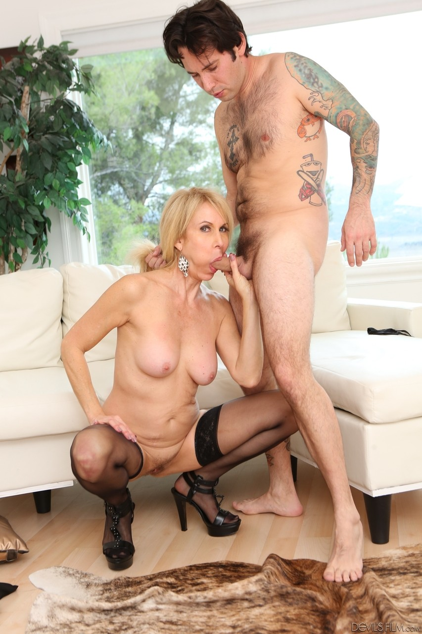 Mature lady in black stockings Erica Lauren gets fucked and jizzed by her hunk