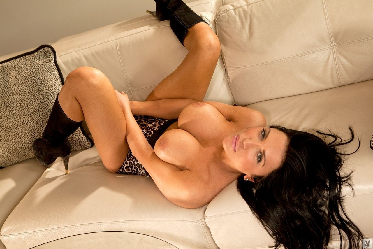 Brunette in black Lana Grazovskaya shows her fake tits on the couch