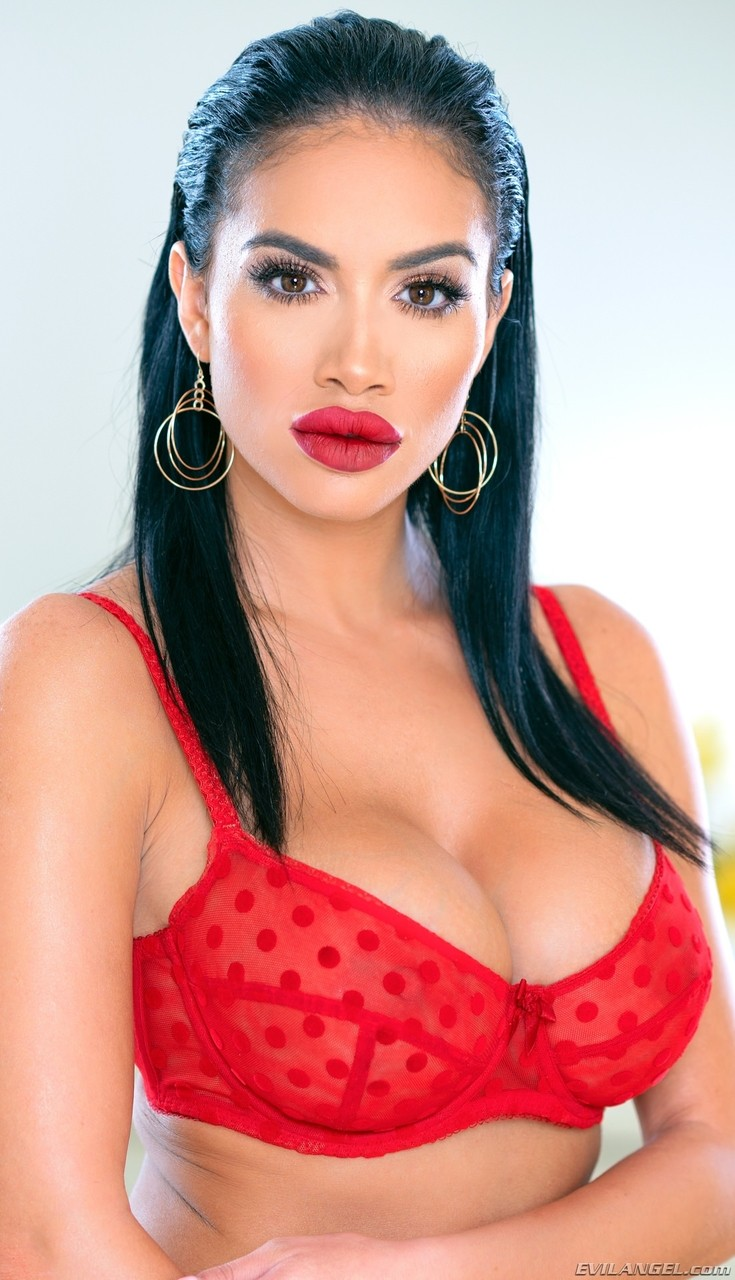 Fake titted Latina Victoria June flaunts her big red lips  flashes pussy
