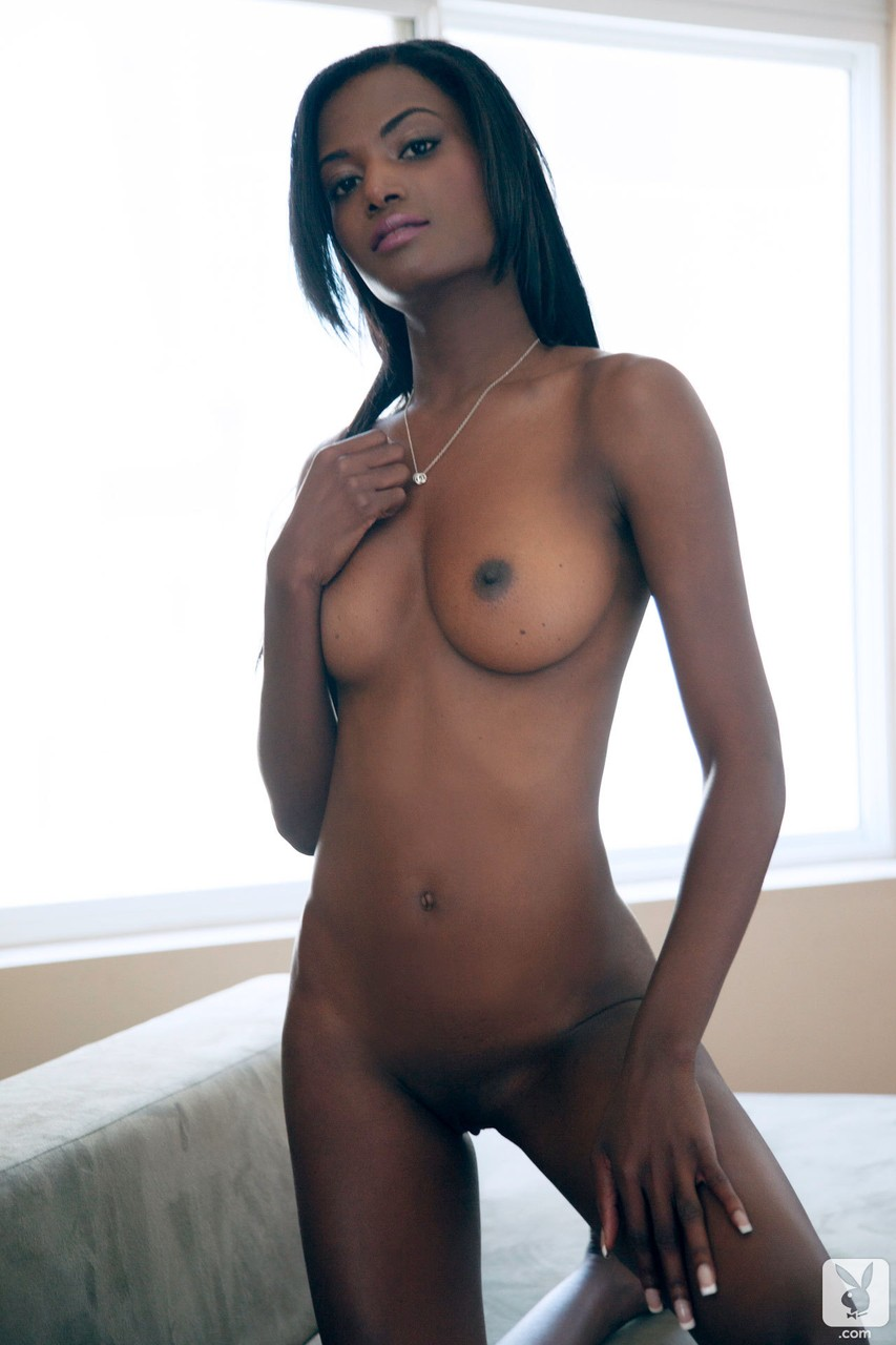 Black babe with natural tits Danielle Nicole flaunts her body in a solo