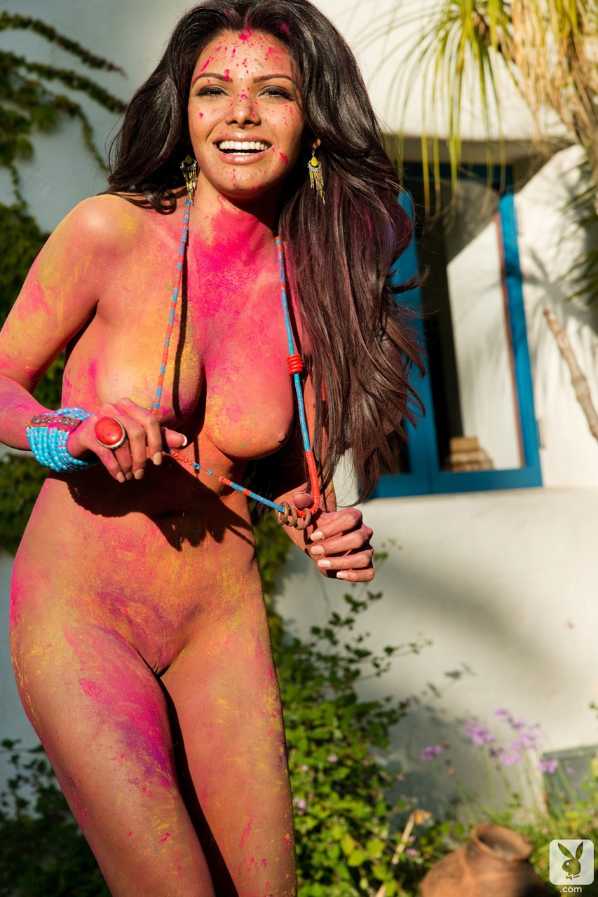 Attractive Indian actress Sherlyn Chopra getting naked and dirty outdoors