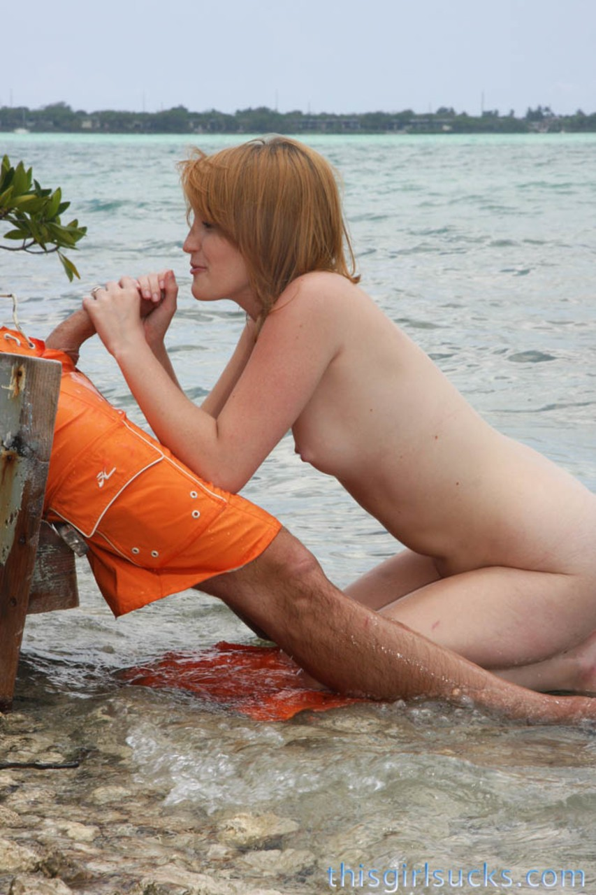 Cute 18 year old ginger Katey Grind wanks and sucks huge penis on the beach
