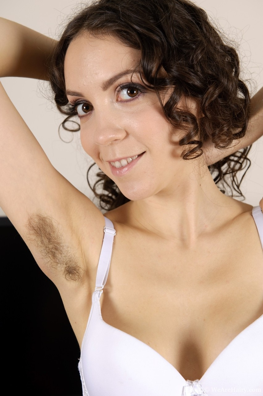 Adorable curly haired Lilly C proudly shows off hairy armpits  pussy at work
