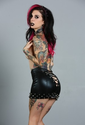 Goth girl Joanna Angel peels of leather clothes to model in the nude