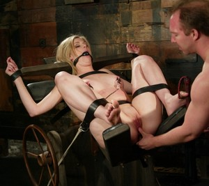 Blonde female Fayth Deluca is strapped tight while being forced to submit