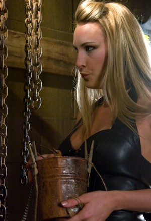 Blonde dominatrix tortures her male sub before milking his dick