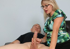 Clothed sex therapist Vicky Vixxx gets cum on glasses after giving a handjob