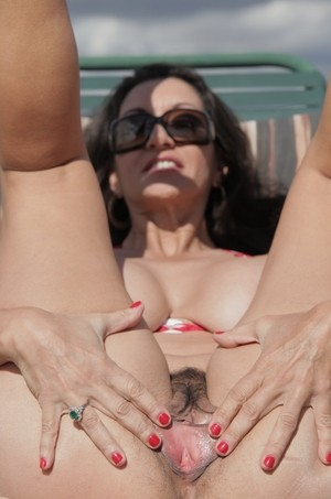 Mature lady Persia Monir sets her D cup boobs free from her bikini top
