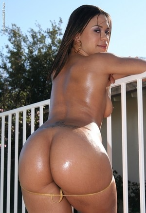 Ebony female Chyanne Jacobs bares her C cup boobs as she removes her swimsuit