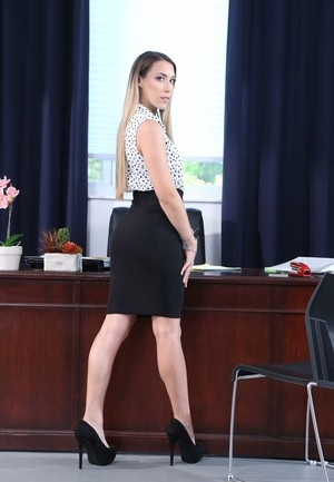 American secretary Kimber Lee strips naked on top of her office desk