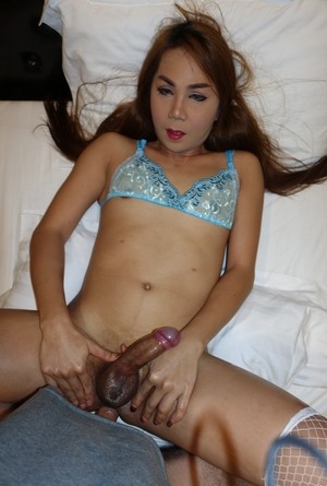 Redhead ladyboy with a bog dick crossses swords during sex with a man