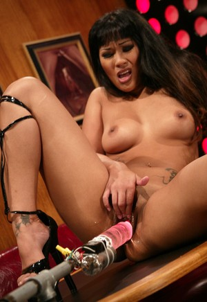 Asian American Dragon Lily pleasures herself with a machine dildo