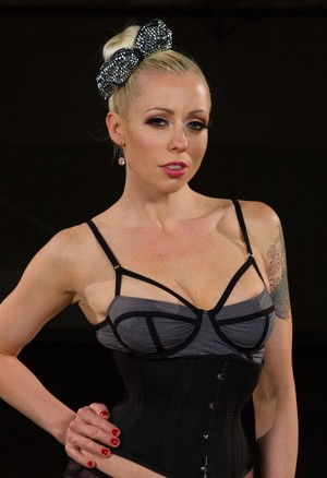Mistress Lorelei Lee demonstrates her cock size preference in lingerie