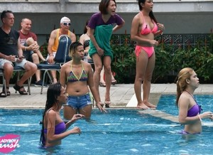 Ladyboys have a game of pool volleyball prior to awards banquet