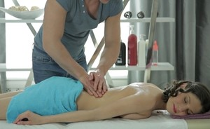 Beautiful female gets fucked from behind on all fours by her masseur