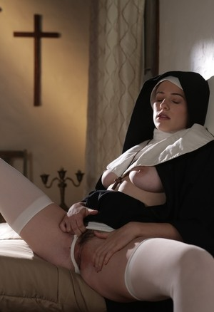 Horny blonde nun Riley Nixon pleases herself at the monastery