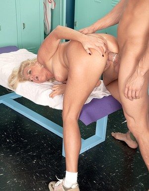Middle-aged blonde Samantha Ray blows and bangs a younger guy in a locker room