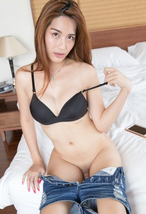 Asian shemale with great legs releases her shepenis from her denim shorts