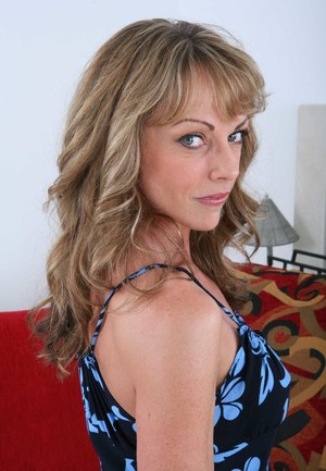 Hot older woman Shayla LaVeaux slips off her dress and panties to pose nude
