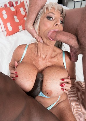 Hot older lady Sally D'Angelo fucks a black and white man at the same time