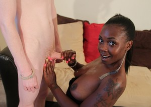 Black chick coaxes the jizz out of a white boy's dick with a handjob
