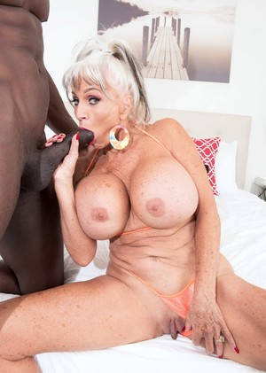 Big titted nan Sally D'Angelo gets banged by a black man in an outdoor Jacuzzi
