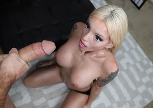 Blond girl Bella Ink pleasures her man's big dick with talented hands and tits