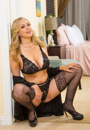 Blonde cougar Julia Ann lets her big boobs spill out of her bra