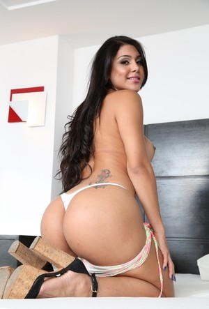 Beautiful Latina T-girl Tifanny Taillon whips out her big dick after disrobing