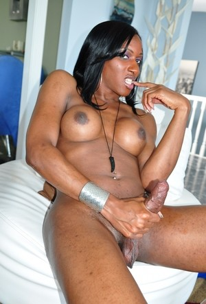 Black shemale Ts India whips out and jerks off her massive tranny cock