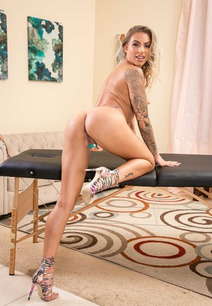 Tattooed blond Juelz Ventura shows off her great legs prior to stripping naked