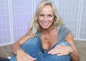 Older Canadian woman Dani Dare delivers a CFNM handjob upon a large dick