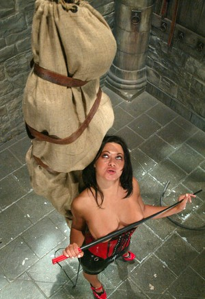 Brunette Domme Sandra Romain suspends a man in a bag before beating him