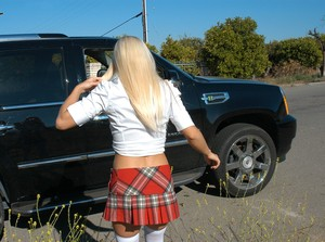 Young blonde girl Jessie Volt flashes some bare ass as she gets in a truck