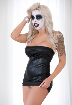 Solo model Nina Elle dons corpse paint and proceeds to strip naked