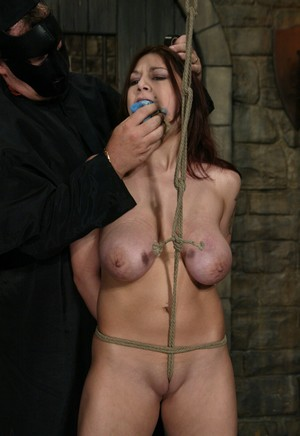 Busty redhead Mallory Knots is gagged and bound with a rope before tit torture