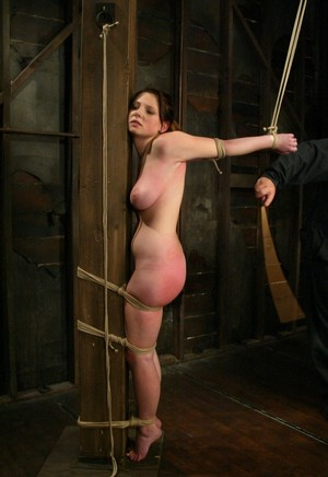 18 year old girl Sara Scott has her ass beat red while tied up in dungeon