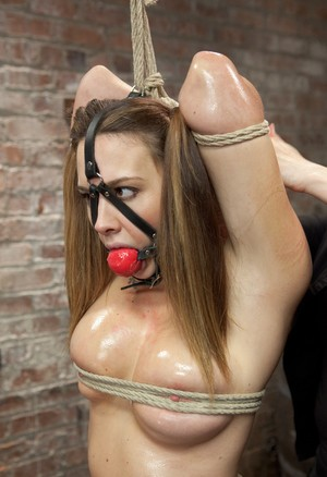 Nude girl Chanel Preston is ball gagged and suspended before being masturbated