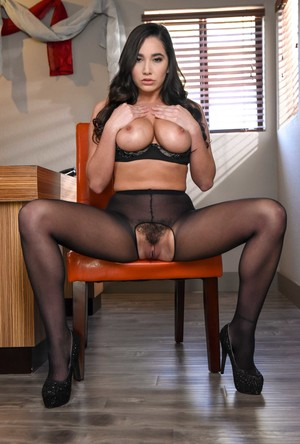 Busty brunette female Karlee Grey takes off crotchless pantyhose