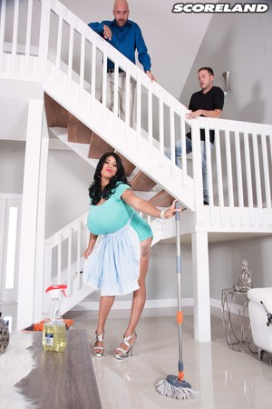 Brunette maid Roxi Red gives up her massive boobs to two guys at once