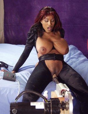 Bog boobed female Africa pleasures herself with a sex machine on her bed