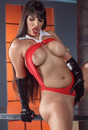 Dark haired chick  Mercedes Carrera shows off her large Vampirella tits