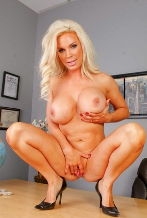Big titted blonde Principal Diamond Foxxx strips naked in her office