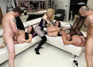 4 horny girls take on 2 studs in a wild group sex scene atop leather furniture