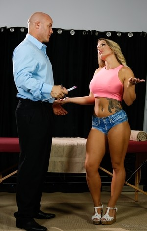 Busty masseuse Cali Carter bangs two men at the same time to ease conjestion