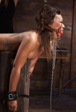 Cruel female Isis Love hooks Leilani Leeane up to shock delivering devices