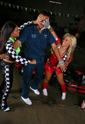 Female go-kart racers settle their on-track differences with a threesome