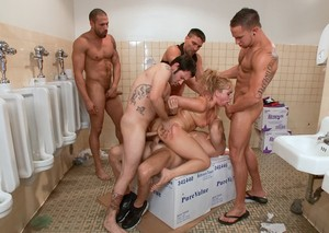 Middle-aged woman lives out her gangbang fantasy in mens bathroom